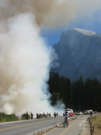 Onlookers watch smoke rises from Yosemite Valley