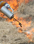 Drip torch setting fire to a field