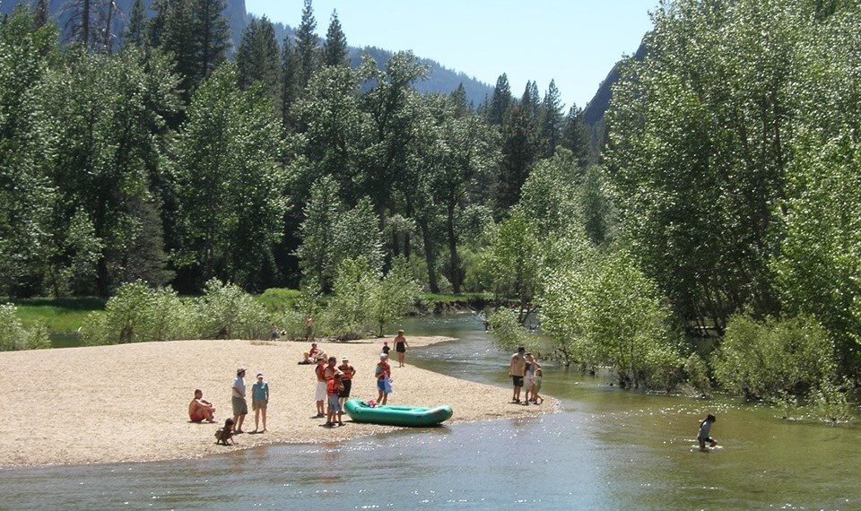Visitors enjoying the Merced River in July 2008