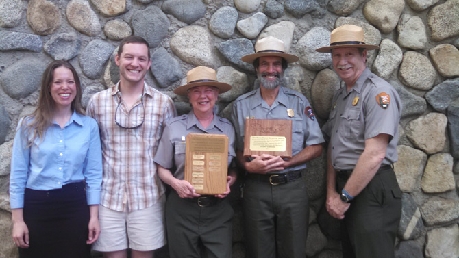 Glenn Gibbons, pictured in uniform holding the plaque, is joined by fellow Yosemite National Park employees. Yosemite National Park Superintendent Don Neubacher is at the far right.