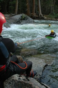 Yosemite Search and Rescue staff trains for swiftwater rescue in the cold Merced River