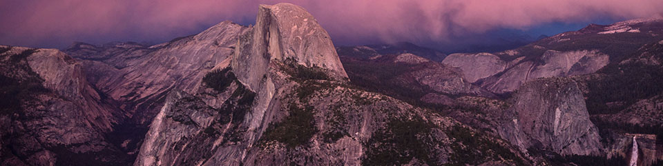 Half Dome with purplish sunset glow