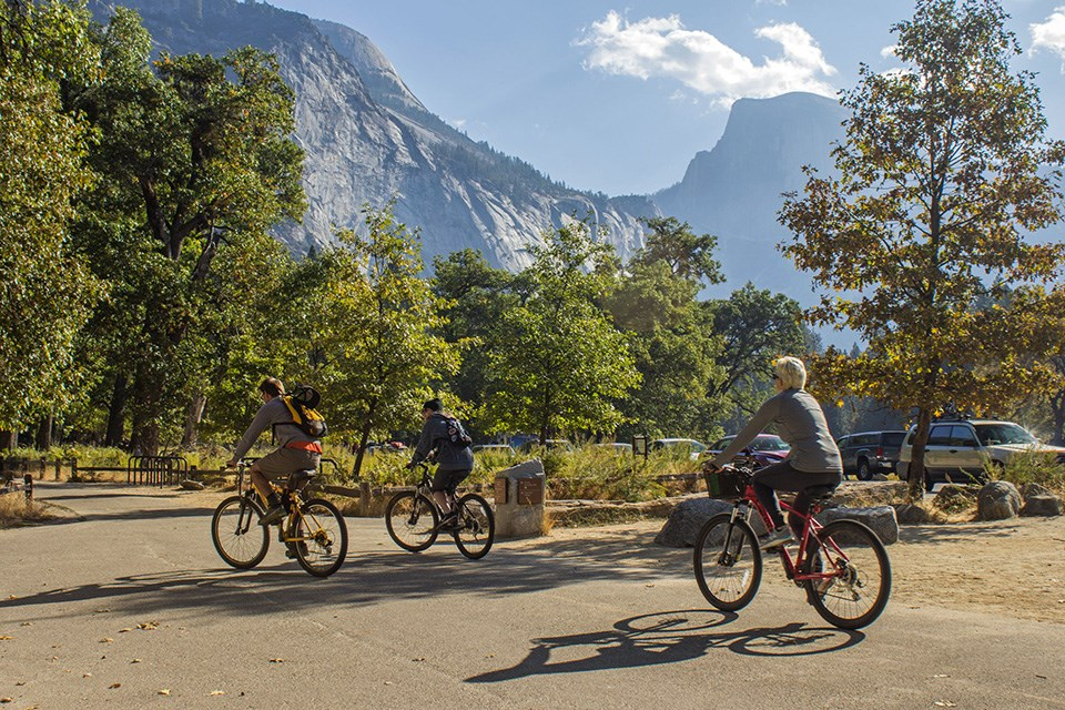 Biker's on bike path in Yosemite Valley with Half Dome in Background