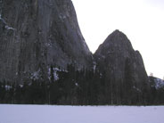 Lower and Middle Cathedral Rock loom over snow covered meadow