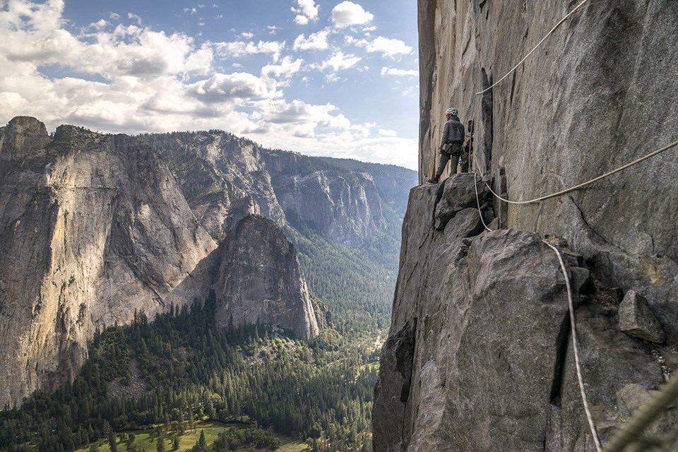 Climber and ropes looking across the Valley while on El Capitan