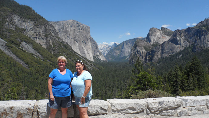 Two women standing at Tunnel View