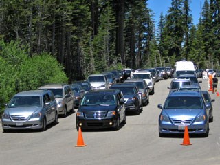 Three lines of cars waiting at a checkpoint