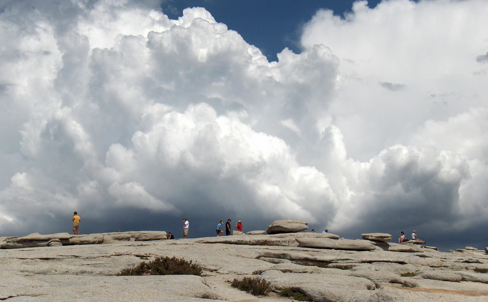 Towering cumulus clouds as seen from the top of Half Dome.