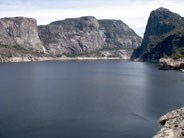 Kolana Rock (right) and Wapama Falls (left) rise above Hetch Hetchy Reservoir