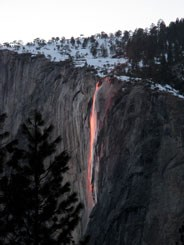Glowing waterfall falling over side of El Capitan