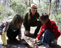 Junior Rangers and NPS Ranger with bear pelt