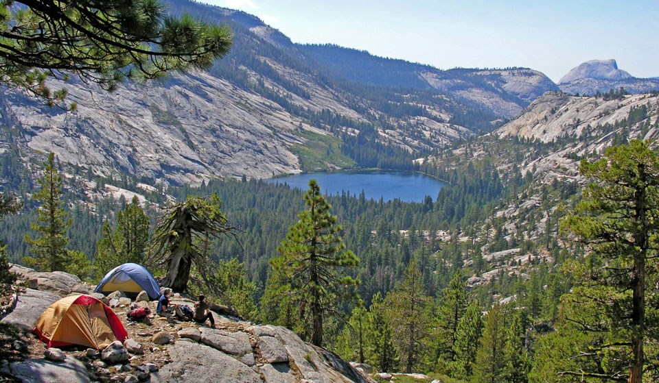 Merced Lake and the back of Half Dome with backpackers and tents
