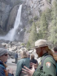 Park ranger talking to visitor at Lower Yosemite Fall
