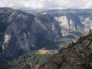 Three Brothers and Yosemite Falls, with Yosemite Valley floor below, from Taft Point