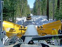 Snow plows working on the Tioga Road