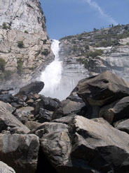 Wapama Falls heads toward boulders at its base
