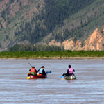 Three canoers on the Yukon River