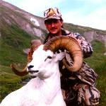 A hunter with a dall sheep ram