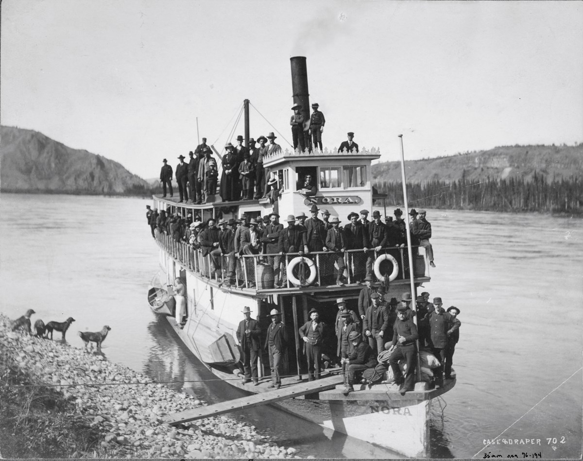 Steamboat Nora fully loaded with stampeders departing Canadian territory for Nome, 1899