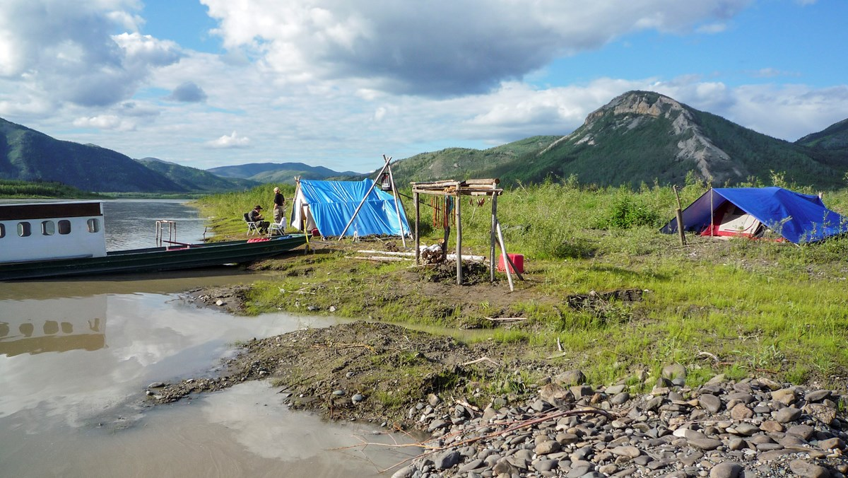 Traditional fish camp and boat on the Yukon River