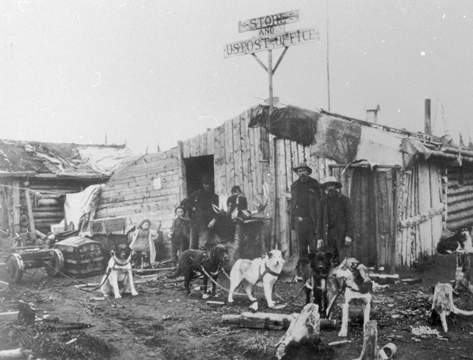 Residents of the newly established Alaskan town of Star City assemble in front of their post office, ca. 1899