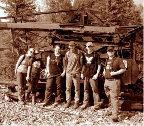 ASRA archaeology students standing in front of historic mining equipment