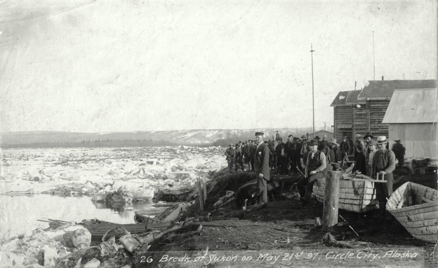 Circle City residents watch ice breaking up on the Yukon River, May 21, 1897.
