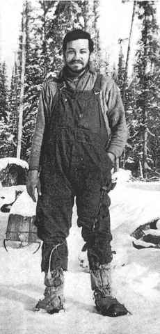 Leon Crane at Al Ames' cabin during a recovery mission to the B-24 crash site the year after his ordeal.