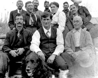 Frank Slaven with Group of men (no date)