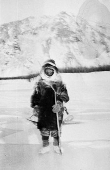 "1935 photograph of ""Cap"" Adolphus, a Gwich'in Athabascan man born in 1884, standing on Yukon River ice at 67 degrees below zero."