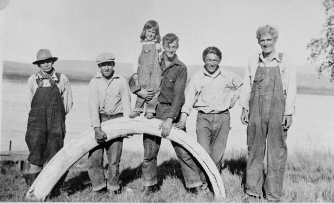 The Biedermans and friends with a Mammoth tusk circa 1930s