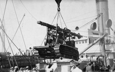 """The Prospecter"" drill rig begin unloaded from a steamship, 1934."