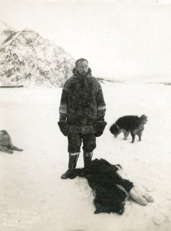Historic photo of Roald Amundsen and his sled dogs on the frozen Yukon River near Eagle, Alaska.