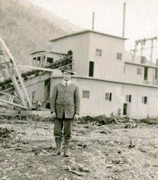 Historic photo of Johnson at the CJ Berry Dredge near circle, Alaska circa 1915.