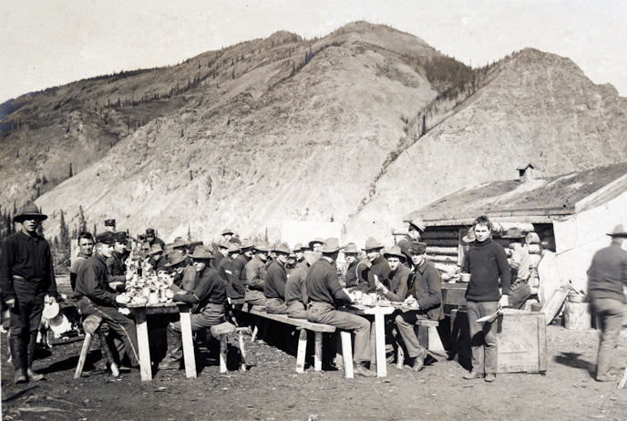 U.S. Army soldiers lunching during the construction of Ft. Egbert at Eagle City, 1899