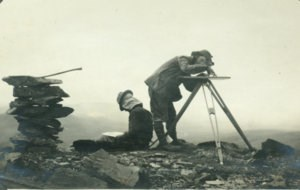 Historic photo of two topographers mapping the international boundary in 1910.