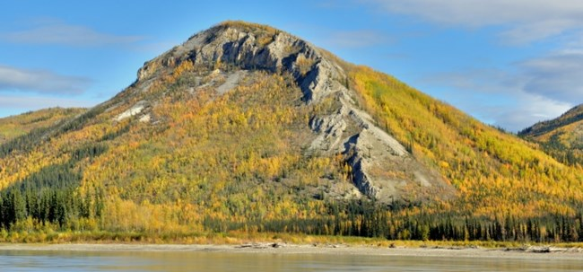 The tall Tahkandit Limestone bluffs near Nation River