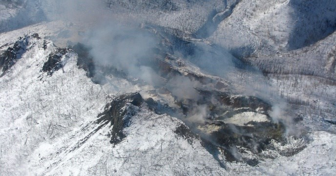 An aerial view of the Windfall Mountain Fire in winter