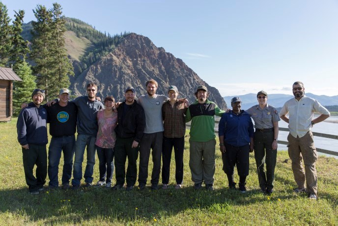 Student Conservation Association workers & NPS Fire staff in front of Eagle Bluff along the Yukon River in Eagle, Alaska