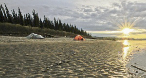 Tents set up on the bank of the Yukon River