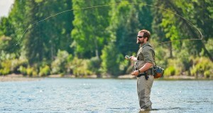 A man fly fishing on a river