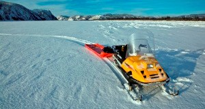 A snowmachine on the Yukon River in winter