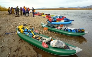 Kayaks on the shore of the Yukon River
