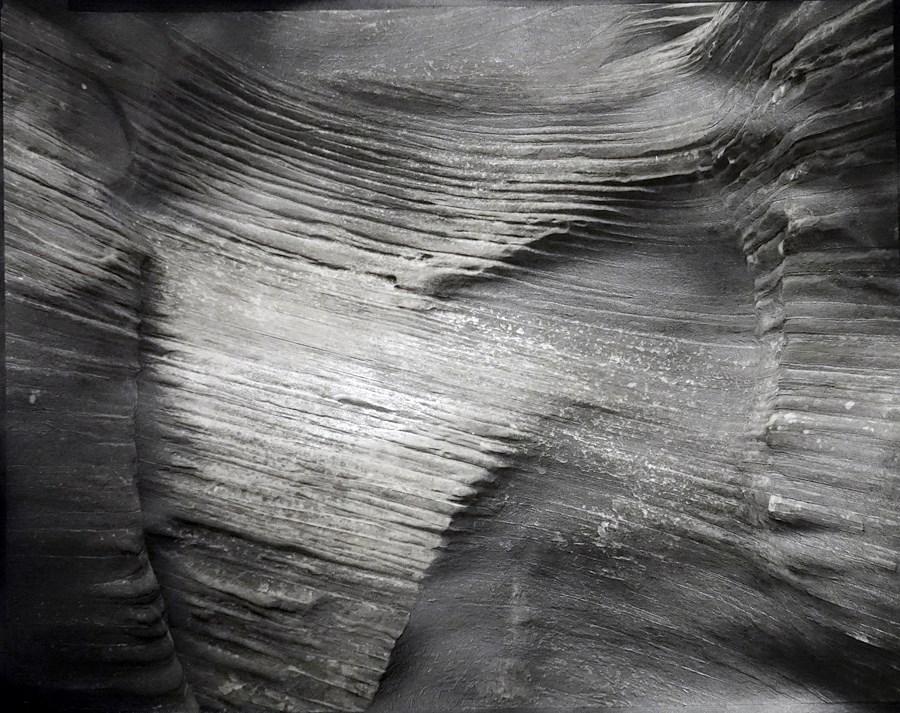 Black and white detail photo of smooth sandstone texture