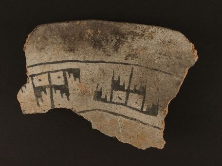 Washington Black-on-gray bowl sherd found in one of the storage cists at the Watchman Site. This ceramic design style dates approximately A.D. 700 to 900. Zion Museum Collection ZION 14000