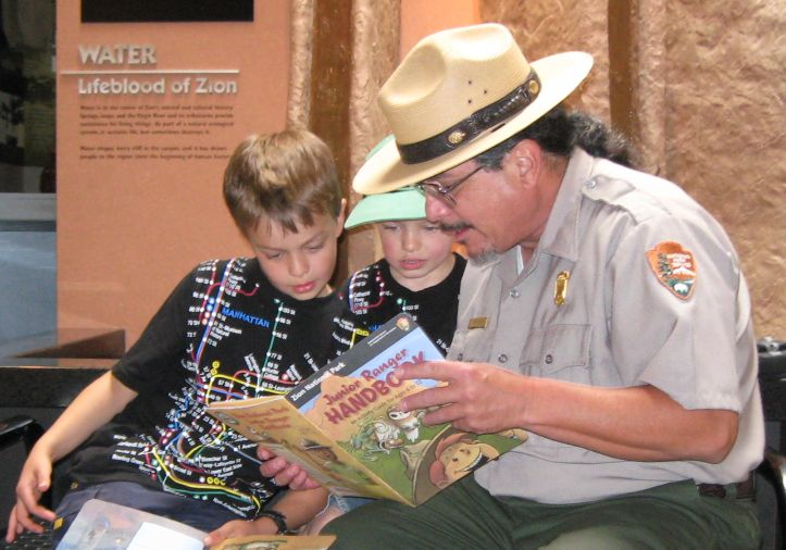 A ranger reviews the Junior Ranger Handbook.