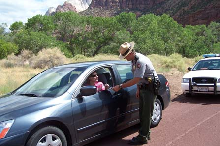 A park ranger pulls over a vehicle.