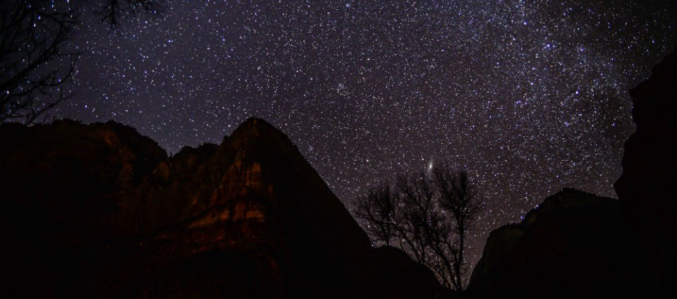 A starry sky above Lady Mountain, as seen from the Zion Lodge