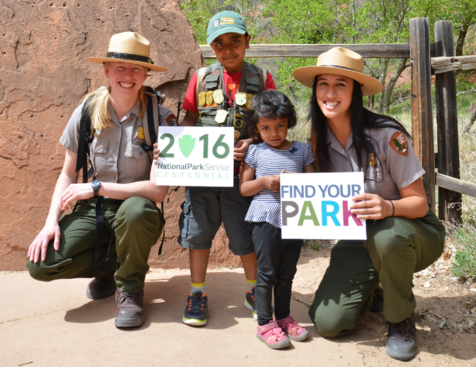 Park rangers and Junior Rangers smiling.