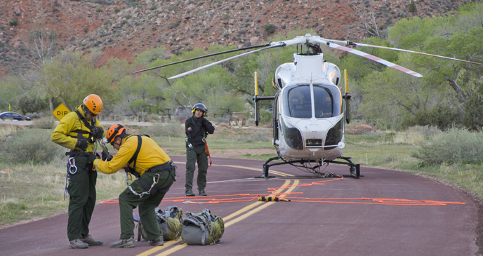 The SAR team preforms a safety check before hooking up to the helicopter.